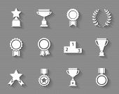 foto of rosette  - Set of white vector award  success and victory icons with trophies  stars  cups  ribbons  rosettes  medals medallions  wreath and a podium on grey - JPG