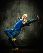 stock photo of break-dance  - Man dancer in cap and jacket showing break - JPG