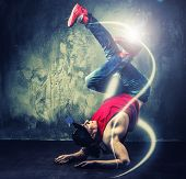 pic of break-dance  - Stylish man dancer showing break - JPG