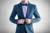 image of coat tie  - Handsome elegant young fashion man in coat tuxedo classical suit and bow tie - JPG