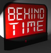 stock photo of running-late  - Behind Time Digital Clock Showing Running Late Or Overdue - JPG