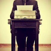 picture of typewriter  - man typing on an old typewriter - JPG