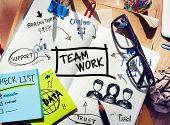 stock photo of collaboration  - Desk with Tools and a Notebook with Ideas About Teamwork - JPG
