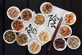 pic of yin  - Chinese herbal medicine with yin and yang calligraphy script on rice paper with herb selection - JPG