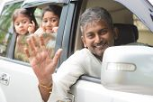 stock photo of goodbye  - Indian family waving hands and saying goodbye - JPG