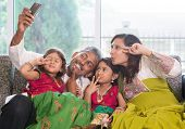 stock photo of indian sari  - Asian Indian family selfie or self photograph at home - JPG