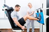 pic of physiotherapy  - Patient at the physiotherapy doing physical exercises using leg press in sport remobilization - JPG