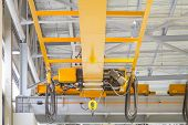foto of crane hook  - Factory overhead crane installation on rail 