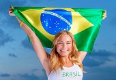 stock photo of cheer up  - Happy fan of Brazilian football team - JPG