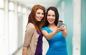 foto of two women taking cell phone  - technology - JPG