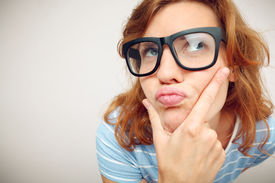 stock photo of nerd glasses  - Portrait of Funny girl in doubt about something  - JPG