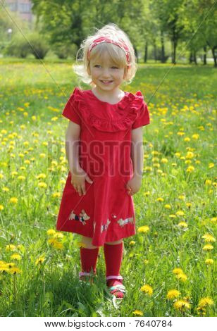 little girl in a red dress for a walk