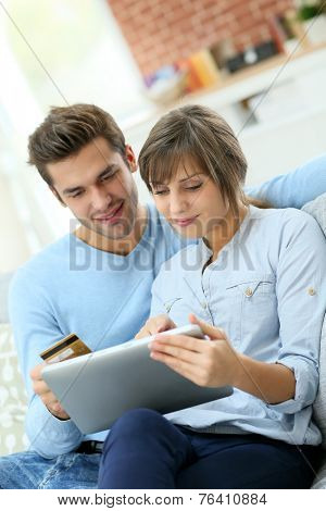 Young couple shopping on internet with tablet