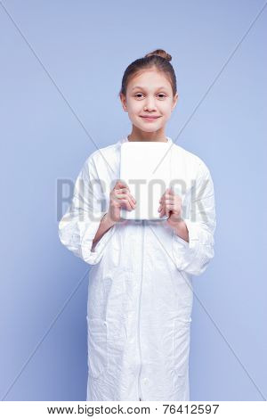 Little Scientist Girl In A Smock With A Digital Tablet