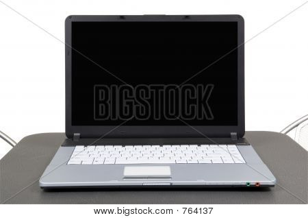 Computer on gray table
