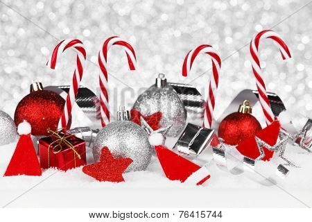 Beautiful red and silver christmas decor on snow