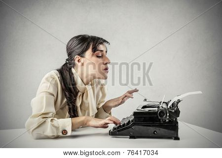 Woman paying attention to what she's writing