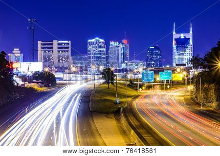 Nashville, Tennessee, USA downtown skyline and highway.
