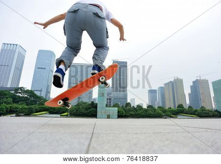 skateboarder skateboarding at city