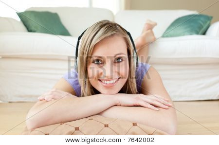 Radiant Woman Listening Music Lying On The Floor
