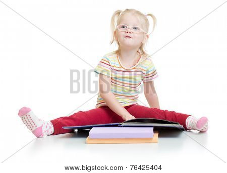 Funny kid in eyeglases reading book isolated on white background