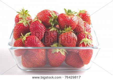 Pile of ripe garden strawberries close-up