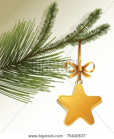 Christmas tree branch with gold star