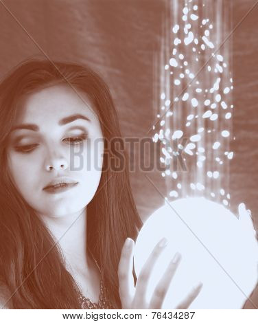 lighting sphere in hands. attractive fairy girl