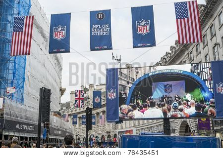 LONDON, UK - SEPTEMBER 27: American flag and NFL banners hanging above screen on Regent street. September 27, 2014 in London. Regent street was closed to traffic to host NFL related games and events.