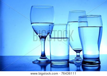 Different glasses of water