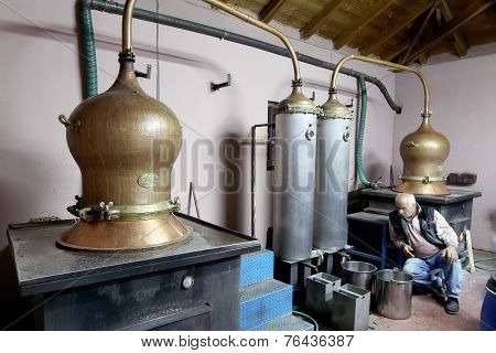 Traditional Distillation Of Alcohol And Production Of Homemade Tsipouro/raki
