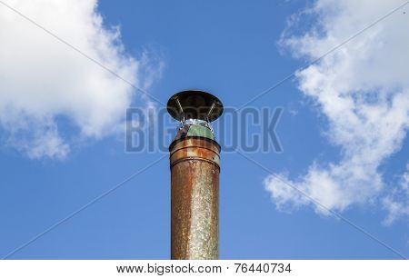 Metal pipe against the sky