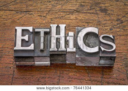 ethics  word in mixed vintage metal type printing blocks over grunge wood