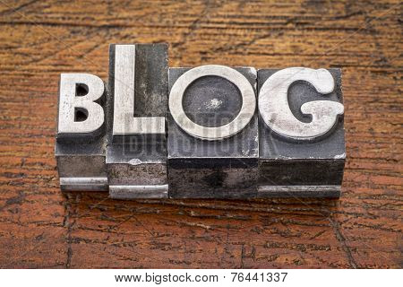 blog word in  mixed vintage metal type printing blocks over grunge wood