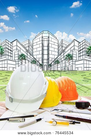 Architect Working Table With Writiing Tool  Safety Helmet And Perspective Plan Drawing Of New Buildi