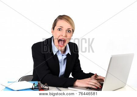 Businesswoman Sitting At Office Desk Working With Laptop In Stress Looking Upset