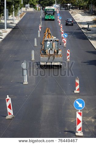 Workers On A Road Construction