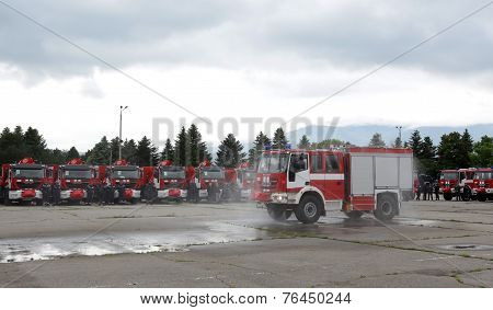 Fire Trucks And Firefighters