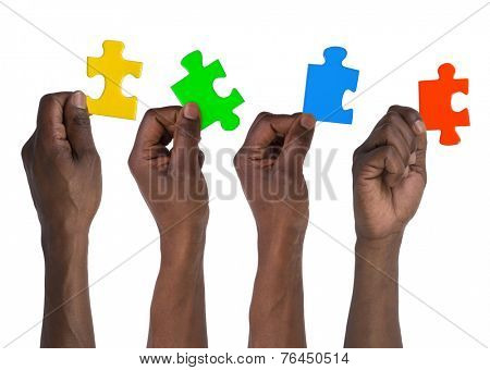 Man holding pieces of jigsaw puzzle