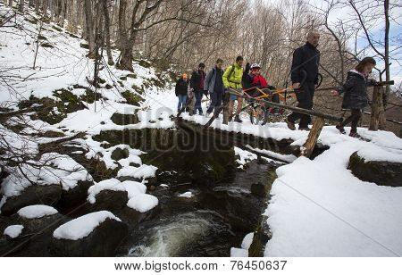 Volunteers And Physically Disabled At A Mountain Trip