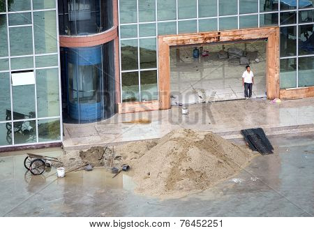 Worker Near Pile Of Sand
