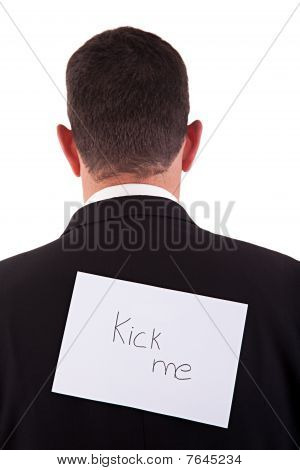 Back Of Businessman, With Kick Me Written In A Paper , Isolated On White Background, Studio Shot.