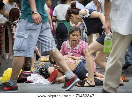 Chinese Woman Begging With Her Scared Child