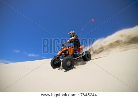 Big Sand Spray From Atv Quadbike Rider In The Dunes