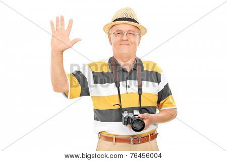 Senior tourist waving with hand isolated on white background