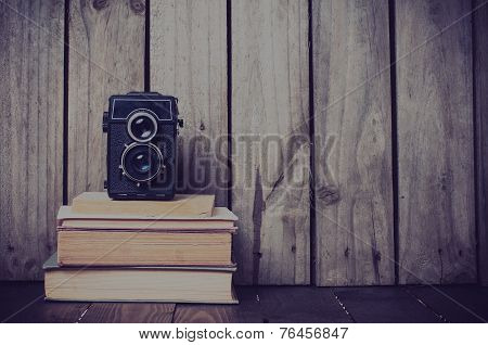 Camera And A Stack Of Books