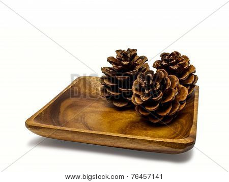 Wooden Plate With Pine Cones.