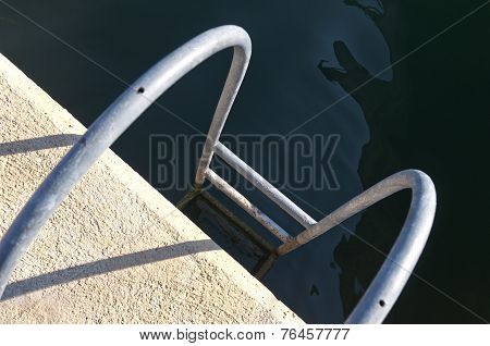 Ladder Leading Into The Water