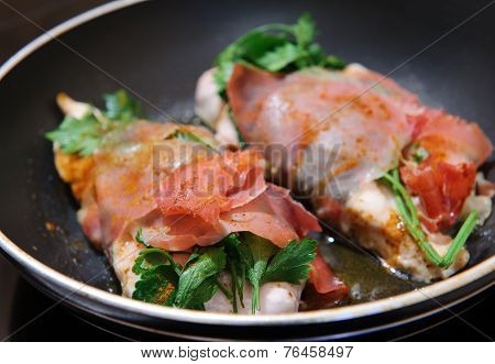 Chicken Breast Wrapped In Parma Ham With Parsley.