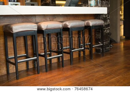 Close up of several bar stool at the nightclub